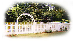 Beautifully designed fence with arched gateway.