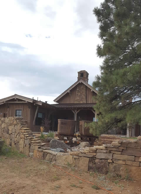 Landscape design using ore cars and stacked-stone walls - Higham property in Boulder