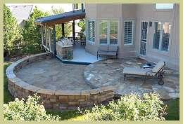 Double-tiered round stone patio and retaining wall