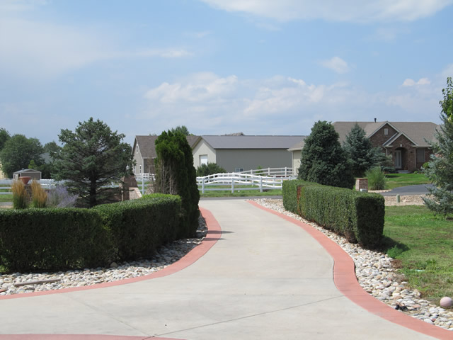 Concrete driveway accented with colored borders in Mead, Colorado