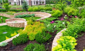 Terraced flower garden with stone walls and sprinkler system