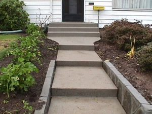 Poured concrete steps and flagstone wall