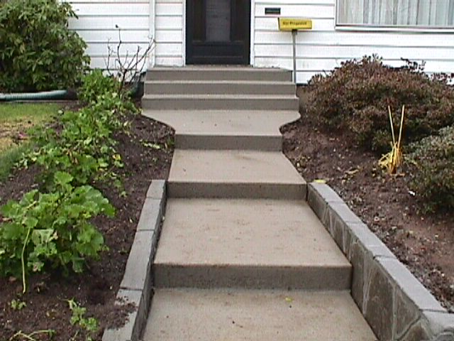 Poured concrete steps and flagstone wall gives a fresh look to this Longmont home